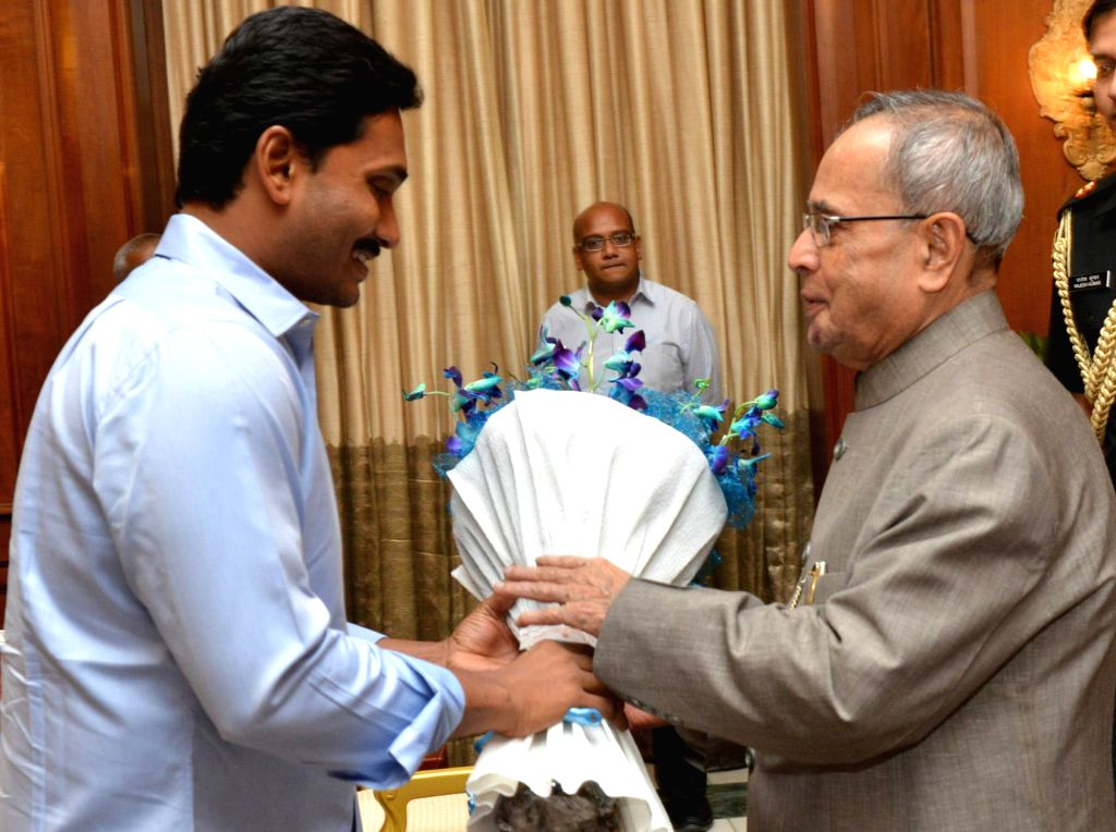 Y S R Congress chief YS Jaganmohan Reddy with President Pranab Mukherjee during a meeting at Rashtrapati Bhawan in New Delhi on July 10, 2014.