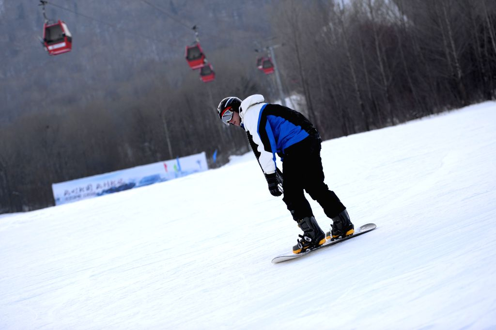 A tourist skis at a ski resort in Yabuli town, northeast China's Heilongjiang Province, Jan. 22, 2015. The town has received nearly 150,000 tourists from Dec. 5, ...