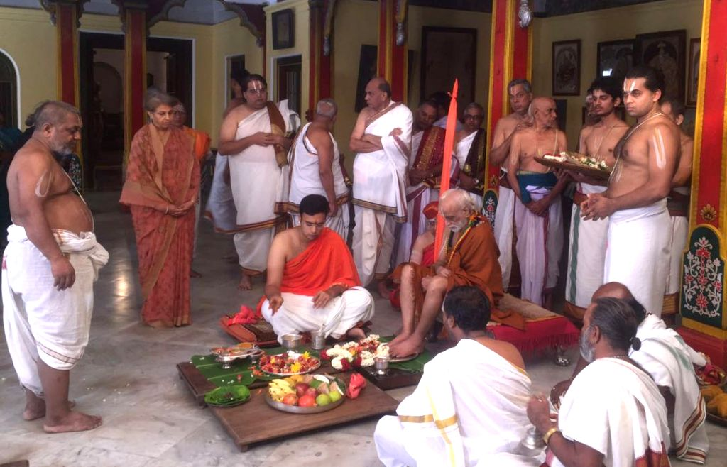 Yaduveer Krishnadatta Chamaraja Wadiyar performs pada puja to Parakala Swamiji as part of his wedding rituals with Trishikha Kumari at the Mysore Palace, in Mysuru, on June 25, 2016.