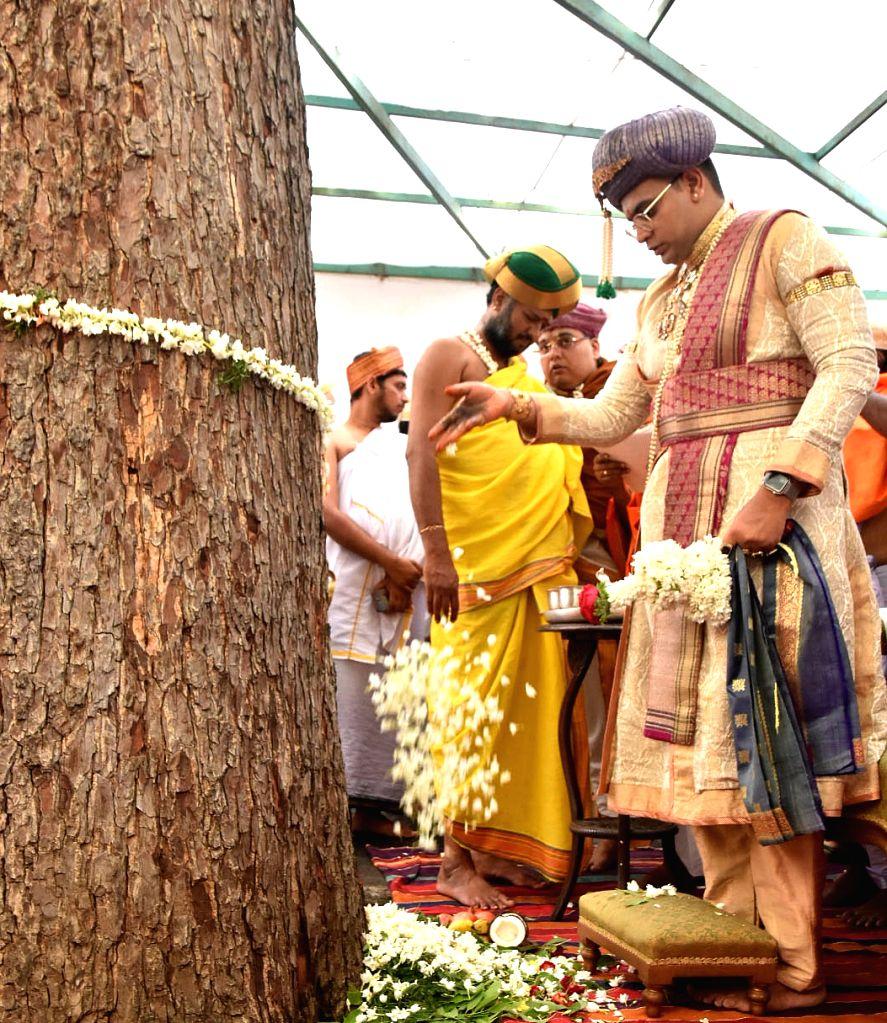 Yaduveer Krishnadatta Chamaraja Wadiyar, scion of the erstwhile royal family of Mysuru, performs rituals as he offers prayers to 'Shami' tree during Dasara celebrations at Mysuru Palace on ...