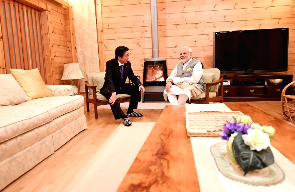 : Yamanashi: Japanese Prime Minister Shinzo Abe hosts Prime Minister Narendra Modi at his personal villa near Lake Kawaguchi in Yamanashi, Japan on Oct 28, 2018. (Photo: IANS/MEA).