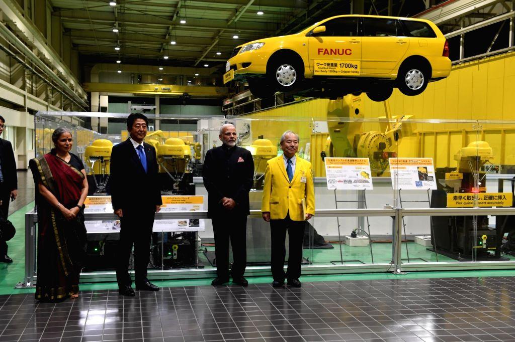 :Yamanashi: Prime Minister Narendra Modi and Japanese Prime Minister Shinzo Abe visit FANUC Corporation facility in Yamanashi, Japan on Oct 28, 2018. (Photo: IANS/MEA).