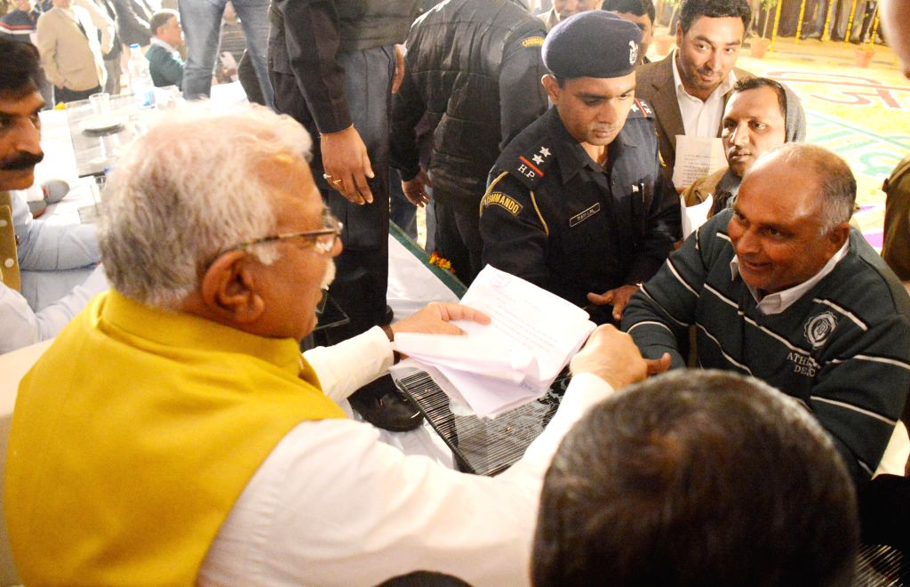 Haryana Chief Minister Manohar Lal Khattar listens to public grievances at Janta Durbar in Yamunanagar district of Haryana on Dec 15, 2014. - Manohar Lal Khattar