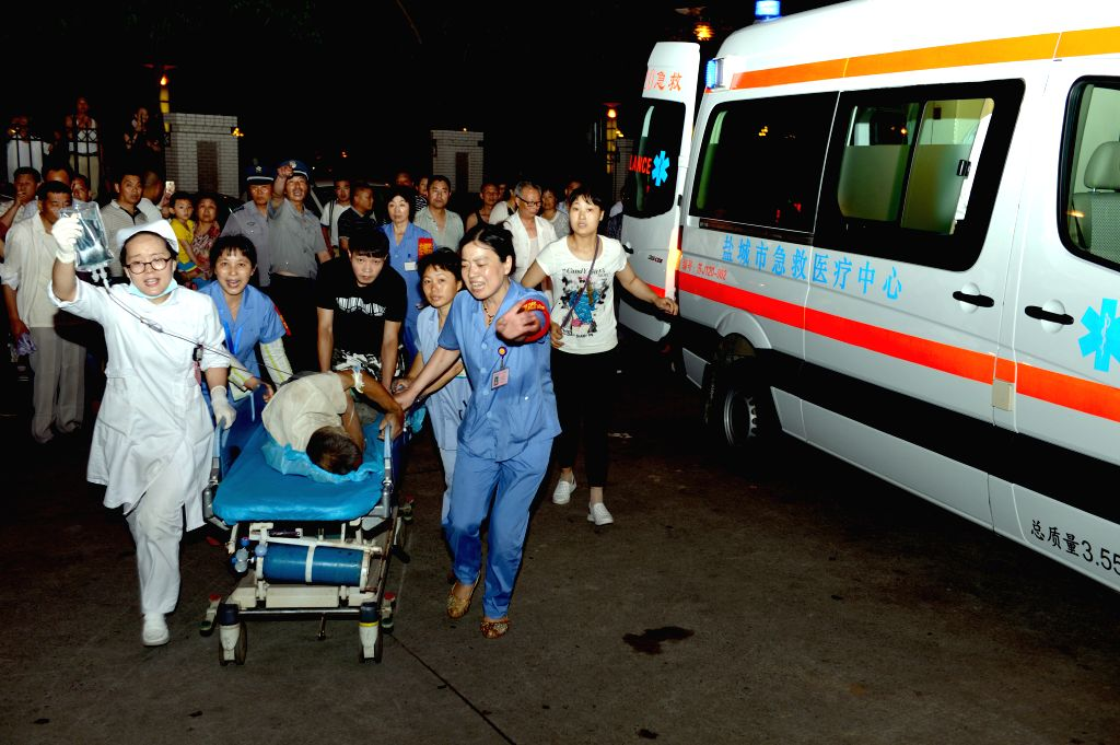 YANCHENG, June 23, 2016 - An injured man is wheeled to a hospital by rescuers in Yancheng City, east China's Jiangsu Province, June 23, 2016. Death toll from extreme weather in east China's Jiangsu ...