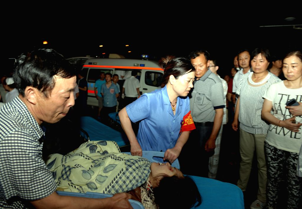 YANCHENG, June 23, 2016 - An injured woman is wheeled to a hospital by rescuers in Yancheng City, east China's Jiangsu Province, June 23, 2016. Death toll from extreme weather in east China's Jiangsu ...