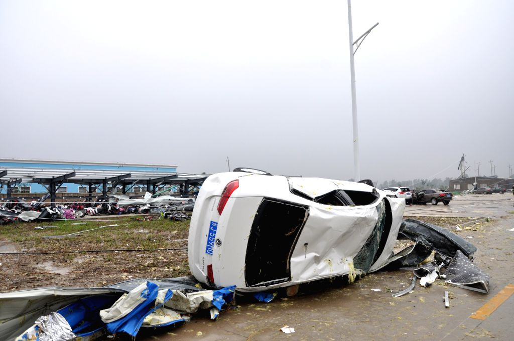 YANCHENG, June 23, 2016 - Photo taken on June 23, 2016 shows a car damaged by weather disaster in Funing County, east China's Jiangsu Province. Death toll from extreme weather in east China's Jiangsu ...