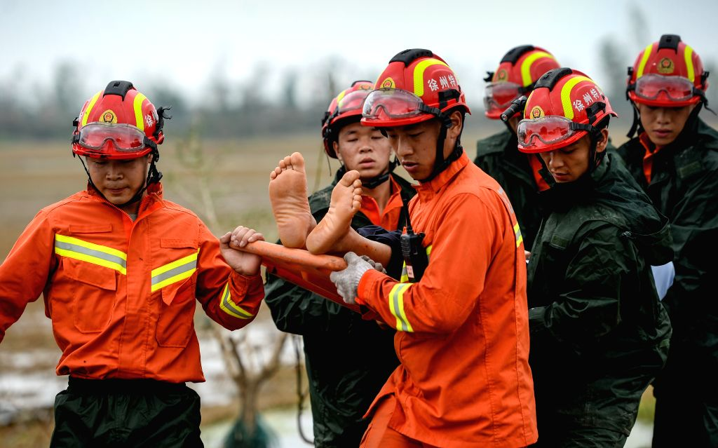 YANCHENG, June 24, 2016 - Rescuers carry an injured villager with a stretcher in Danping Village of Chenliang Township in Funing County, Yancheng City, east China's Jiangsu Province, June 24, 2016. ...