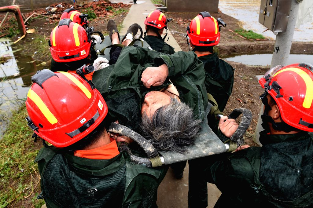 YANCHENG, June 24, 2016 - Rescuers carry an injured villager in Danping Village of Chenliang Township in Funing, Yancheng, east China's Jiangsu Province, June 24, 2016. A total of 98 people were ...