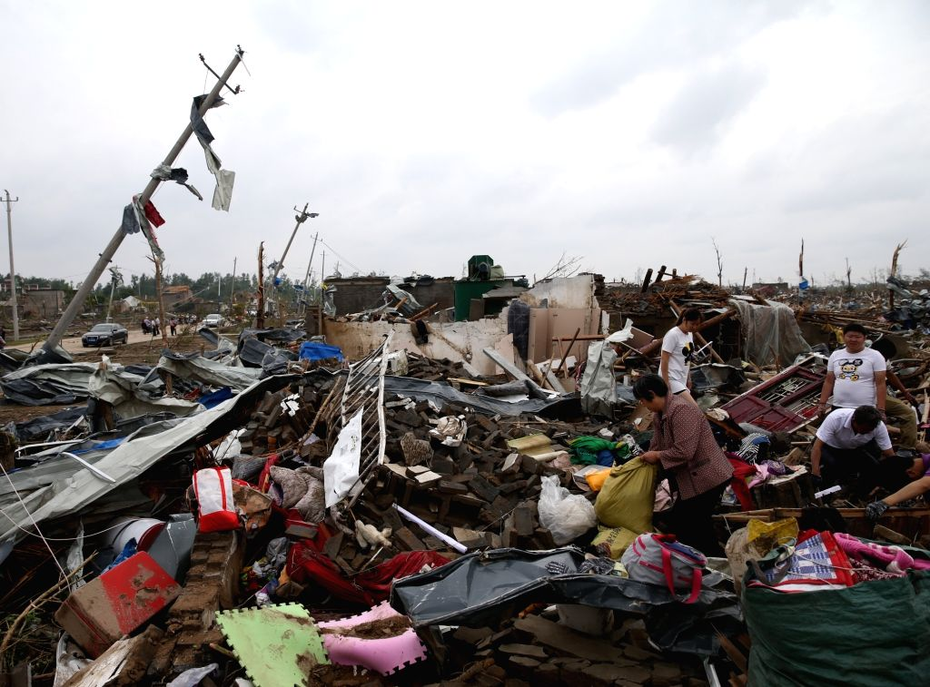 YANCHENG, June 24, 2016 - Villagers search for their belongings at the debris in Beichen Village of Funing County, Yancheng City, east China's Jiangsu Province, June 24, 2016. Death toll of the ...