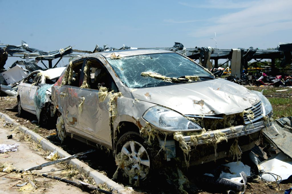 YANCHENG, June 25, 2016 - Photo taken on June 25, 2016 shows the damaged cars parked at Atesi company in Funing County of Yancheng City, east China's Jiangsu Province, June 25, 2016. The dangerous ...