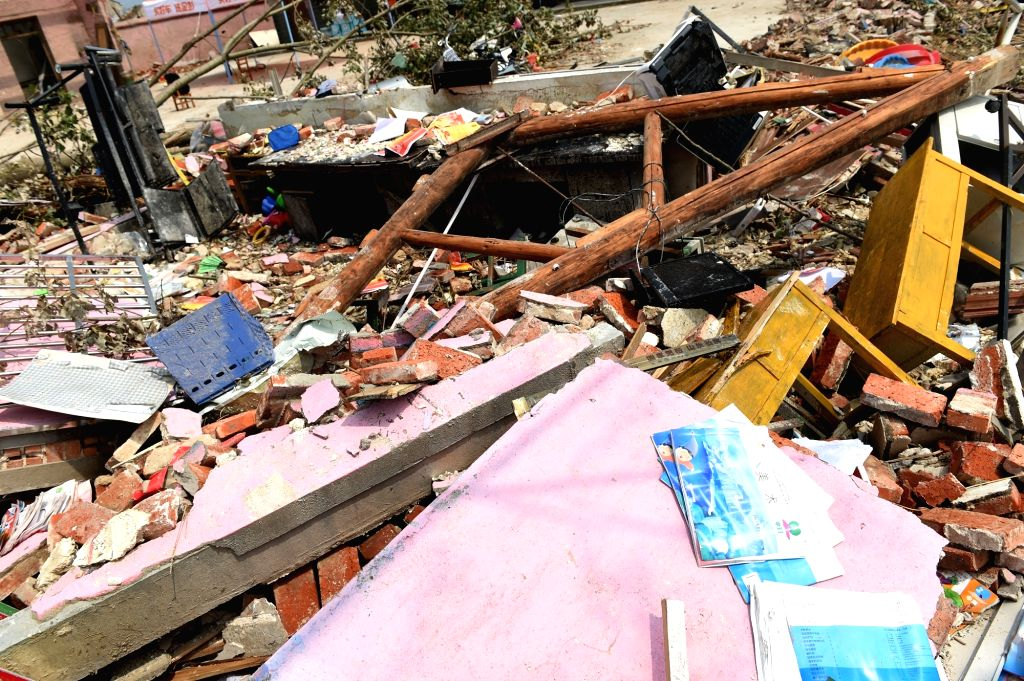 YANCHENG, June 26, 2016 - Photo taken on June 26, 2016 shows debris at Jiqiao Kindergarten in Funing County of Yancheng, east China's Jiangsu Province. The kindergarten was severely damaged when a ...