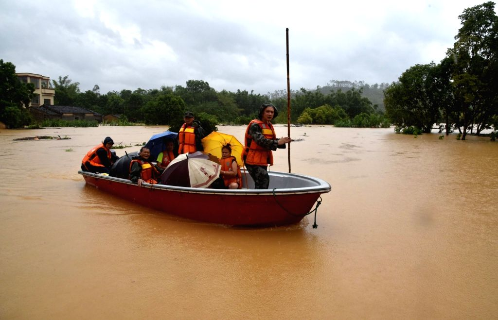 YANGJIANG, Sept. 17, 2018 - Militiamen transfer villagers in Pingxi Village of Yangchun City, south China's Guangdong Province, Sept. 17, 2018. A rain-triggered flood hit Yangchun due to the ...