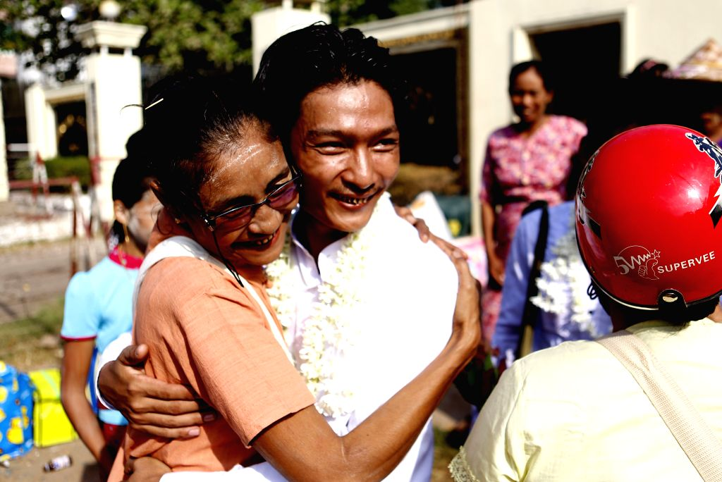 YANGON, April 17, 2016 - A released prisoner (C) hugs his family member outside a jail in Yangon, Myanmar, April 17, 2016. Myanmar's government granted amnesty to 83 prisoners Sunday, the country's ...