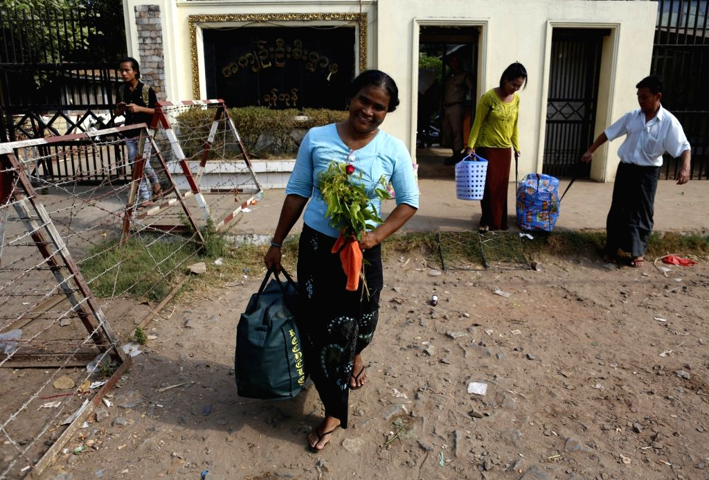 YANGON, April 17, 2016 - A released prisoner carries her belongings outside a jail in Yangon, Myanmar, April 17, 2016. Myanmar's government granted amnesty to 83 prisoners Sunday, the country's ...