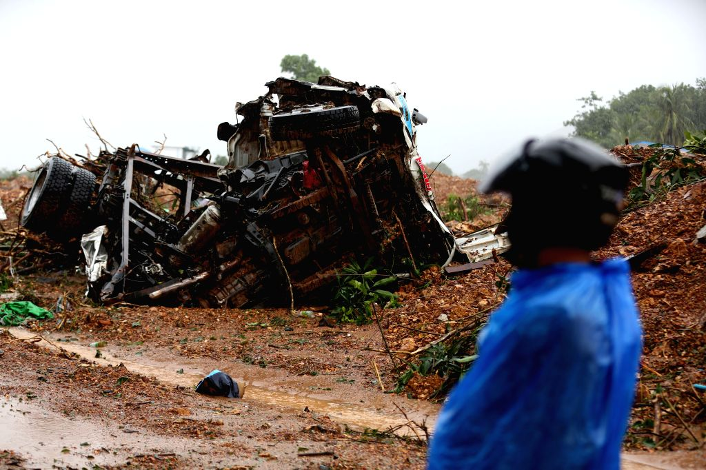 YANGON, Aug. 10, 2019 - Photo taken on Aug. 10, 2019 shows a vehicle destroyed by monsoon landslide in Paung Township, Mon state, Myanmar. Death toll from Friday's monsoon landslide had risen to 29 ...