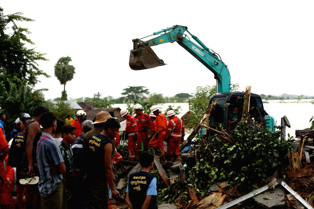 YANGON, Aug. 10, 2019 (Xinhua) -- Members of rescue team carry out operations at the site of monsoon landslide in Mon state, Myanmar, Aug. 10, 2019. Eight more bodies were recovered, bringing the death toll to 41 in a monsoon landslide on Friday in M
