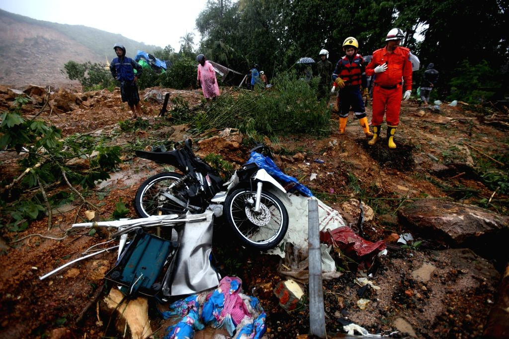YANGON, Aug. 10, 2019 (Xinhua) -- Search and rescue work are carried out at the site of monsoon landslide in Paung Township, Mon state, Myanmar, Aug. 10, 2019. Death toll from Friday's monsoon landslide had risen to 29 so far in Myanmar's Mon state,