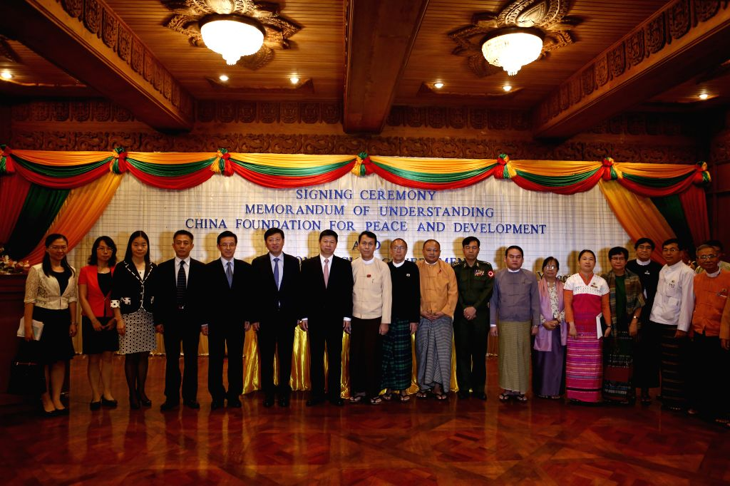 YANGON, Aug. 13, 2016 - Visiting Minister of the International Department of the Central Committee of the Communist Party of China (CPC) Song Tao (7th L) and Yangon Region Chief Minister U Phyo Min ... - U Phyo Min Thein