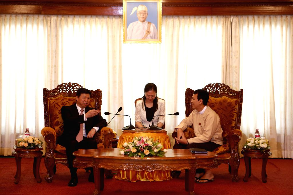 YANGON, Aug. 13, 2016 - Visiting Minister of the International Department of the Central Committee of the Communist Party of China (CPC) Song Tao (L) meets with Yangon Region Chief Minister U Phyo ... - U Phyo Min Thein