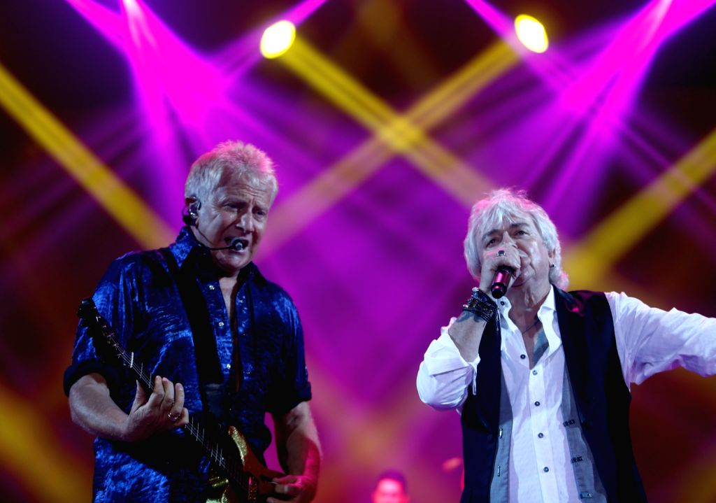 Graham Russell (L) and Russell Hitchcock of the rock band Air Supply perform during the Air Supply Live in Myanmar concert at Myanmar Convention Center (MCC) in