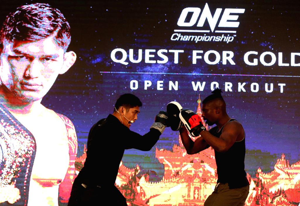 YANGON, Jan. 23, 2018 - Mixed Martial Arts (MMA) fighter Aung La N Sang (L) demonstrates his skill to audience during the open workout of QUEST FOR GOLD in Yangon, Myanmar, Jan. 23, 2018. ONE ...