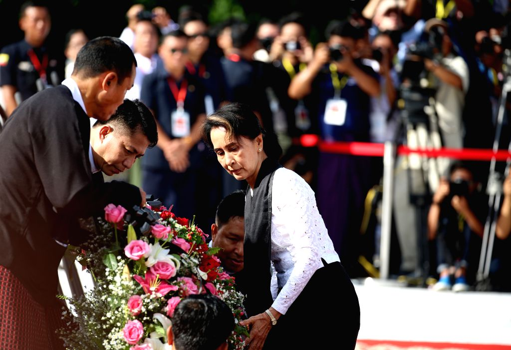 YANGON, July 19, 2019 - Myanmar's State Counselor Aung San Suu Kyi (R, front) lays a wreath during a ceremony to mark the 72nd Martyrs' Day in Yangon, Myanmar, July 19, 2019. Myanmar held a state ...