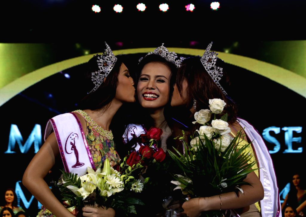 Sharr Htut Eaindra (C) receives congratulations after being crowned in Miss Universe Myanmar 2014 pageant in Yangon, Myanmar, July 26, 2014. Myanmar on Saturday ...