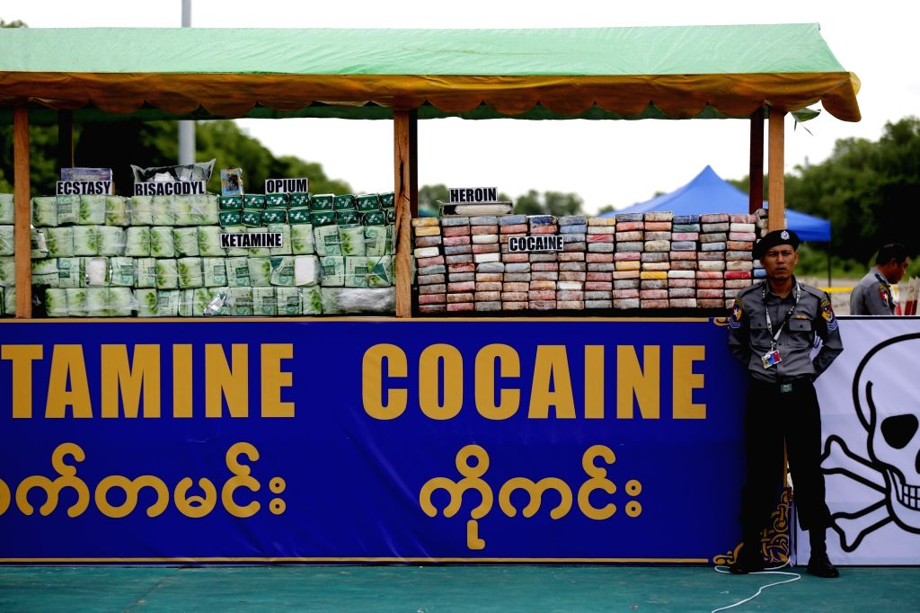 YANGON, June 26, 2017 - A policeman stands next to seized drugs to be burnt in Yangon, Myanmar, June 26, 2017. Myanmar authorities ceremonially burned 25 kinds of seized narcotic drugs in Yangon on ...