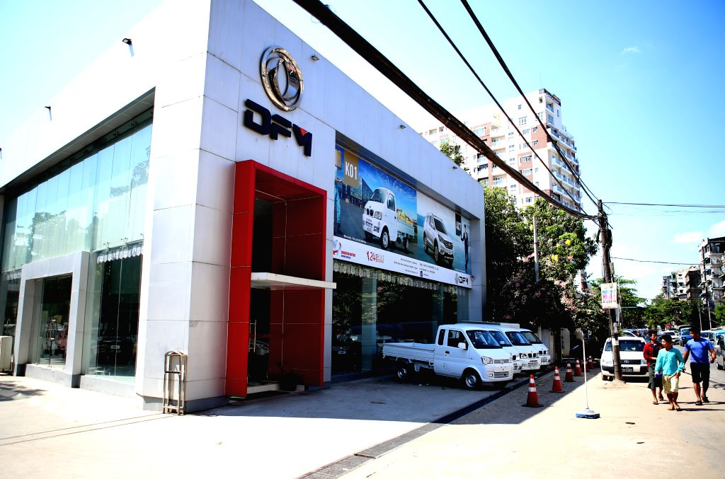 YANGON, March 12, 2017 - Photo taken on March 12, 2017 shows a sale center of Chinese automaker Dongfeng Motor in Yangon, Myanmar. China's investment in Myanmar reached 2.8 billion U.S. dollars in ...