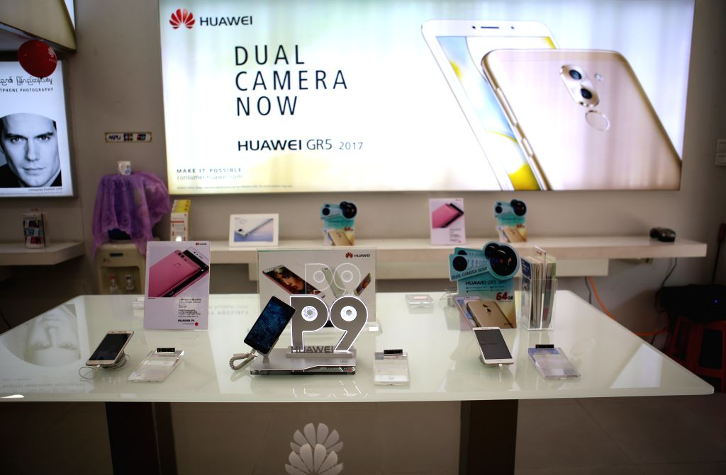 YANGON, March 12, 2017 - Photo taken on March 12, 2017 shows Huawei smartphones displayed at a store in Yangon, Myanmar. China's investment in Myanmar reached 2.8 billion U.S. dollars in this fiscal ...