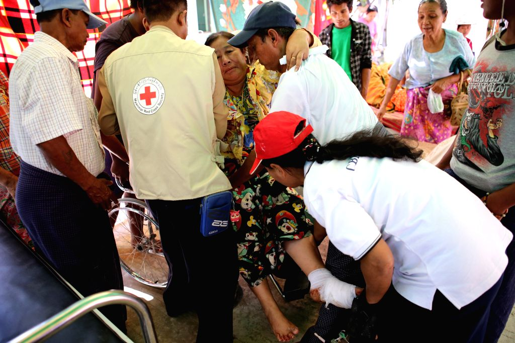 YANGON, March 14, 2017 - An injured woman is treated at a temporary shelter outside the hospital after an earthquake in Taikkyi township of Yangon region, Myanmar, on March 14, 2017. Two people were ...