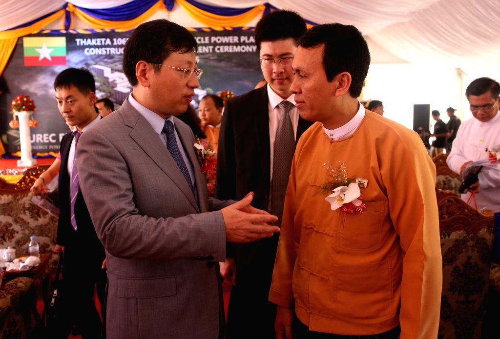YANGON, May 12, 2016 - Chinese Ambassador to Myanmar Hong Liang (L) talks with Chief Minister of Yangon Region U Phyo Min Thein after a cornerstone laying ceremony in Yangon, Myanmar, May 12, 2016. ...