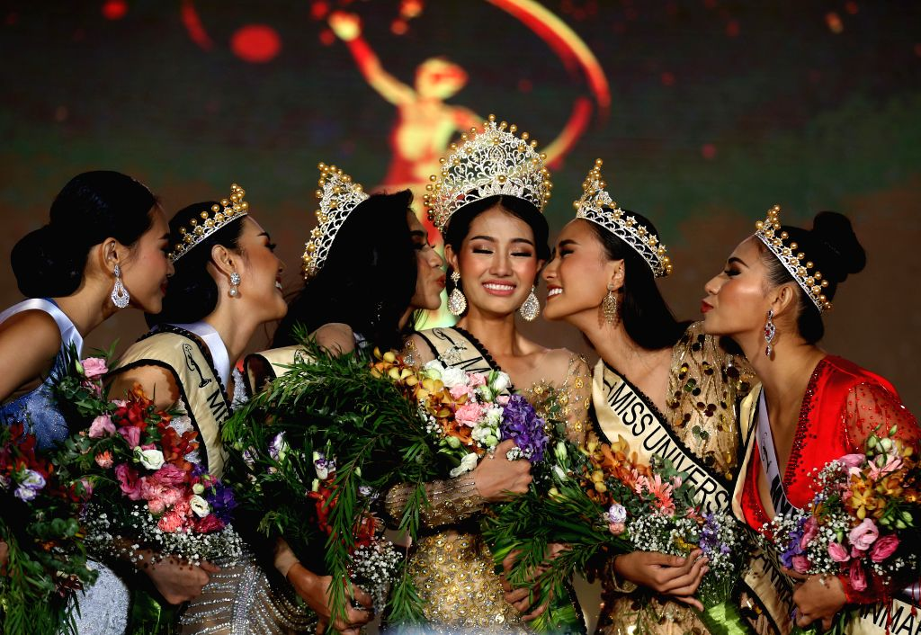 YANGON, May 31, 2019 - Swe Zin Htet (3rd R) receives congratulations after being crowned in Miss Universe Myanmar 2019 in Yangon, Myanmar, May 31, 2019. Swe Zin Htet, from Myanmar's Kayin state, was ...