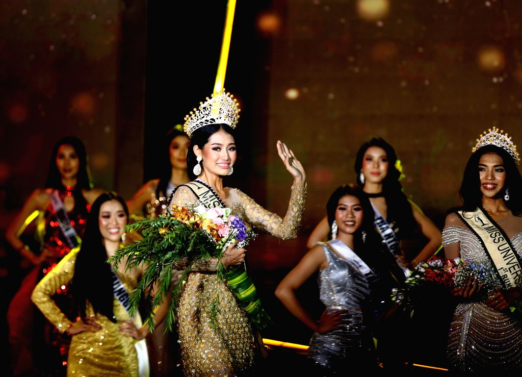 YANGON, May 31, 2019 - Swe Zin Htet (Front) waves after winning the crown of Miss Universe Myanmar 2019 in Yangon, Myanmar, May 31, 2019. Swe Zin Htet, from Myanmar's Kayin state, was crowned the ...