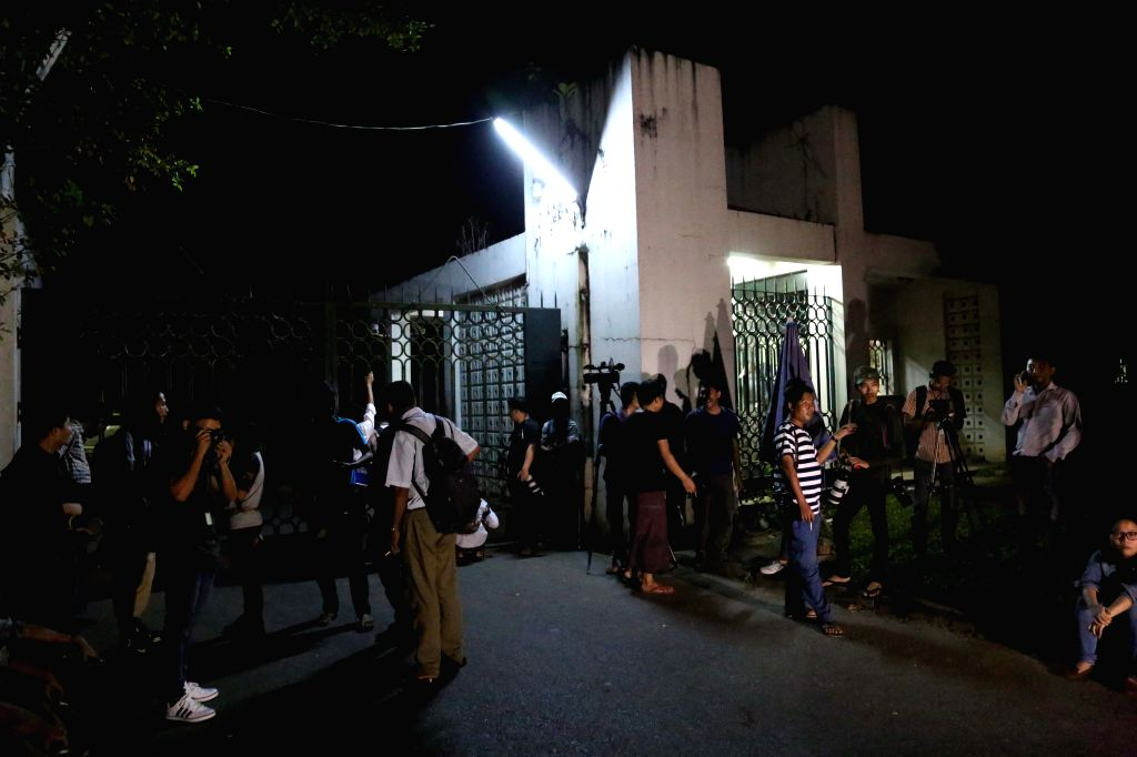 YANGON, Nov. 25, 2016 - Journalists wait in front of an explosion site in Yangon, Myanmar, Nov. 25, 2016. Two minor explosions have hit Myanmar' Yangon regional government office Friday evening, ...