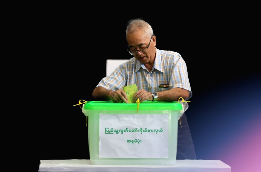 YANGON, Nov. 3, 2018 - A voter casts ballot at a polling station in Yangon, Myanmar, Nov. 3, 2018. A multi-party parliamentary by-election began across Myanmar Saturday morning at 6:00 a.m. local ...