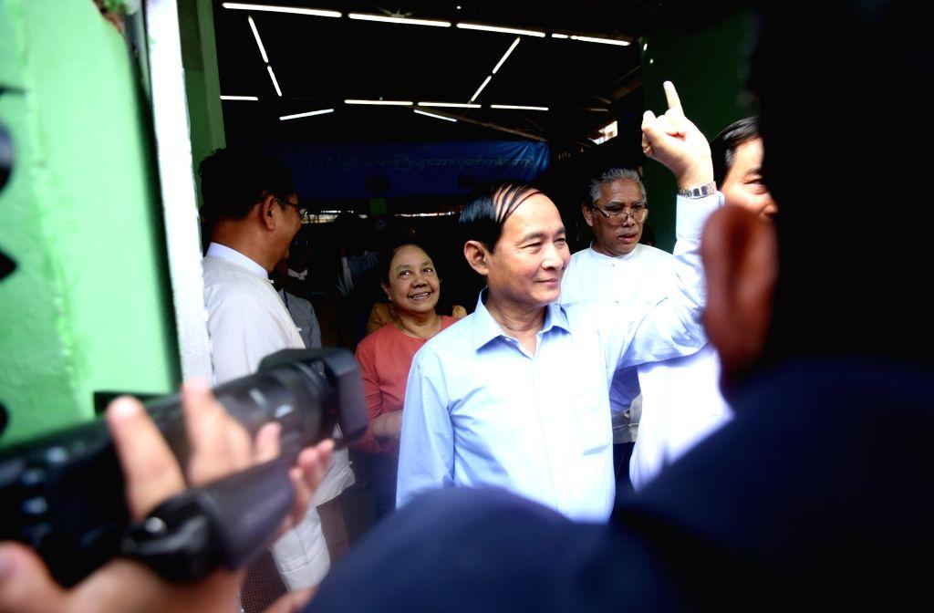 YANGON, Nov. 3, 2018 - Myanmar President U Win Myint (C) shows his inked finger after casting ballot at a polling station in Yangon, Myanmar, Nov. 3, 2018. Myanmar President U Win Myint cast his ...