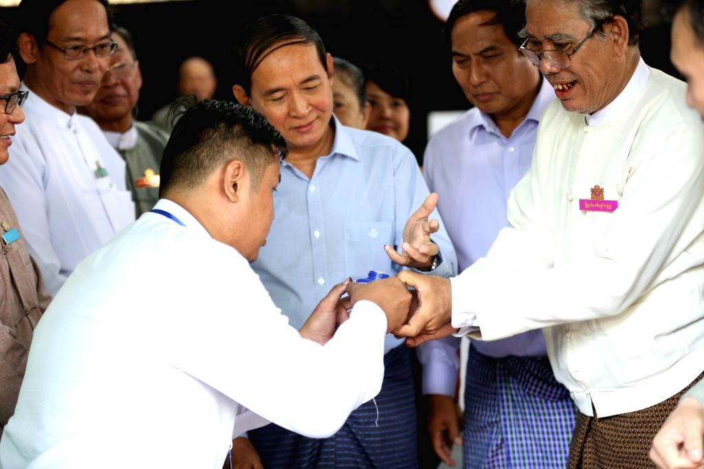 YANGON, Nov. 3, 2018 - Myanmar President U Win Myint (C) marks his finger with ink after casting ballot at a polling station in Yangon, Myanmar, Nov. 3, 2018. Myanmar President U Win Myint cast his ...