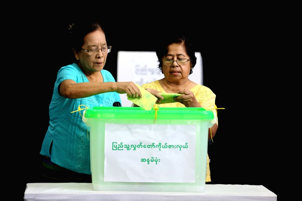 YANGON, Nov. 3, 2018 - Voters cast ballot at a polling station in Yangon, Myanmar, Nov. 3, 2018. A multi-party parliamentary by-election began across Myanmar Saturday morning at 6:00 a.m. local time ...