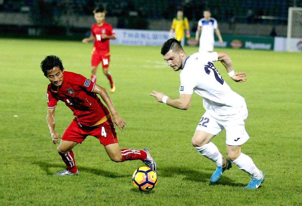 YANGON, Oct. 11, 2017 - Si Thu Aung (L) of Myanmar vies for the ball during the the AFC Asian Cup qualifiers final round Group A match between Myanmar and Kazakhstan at the Thuwanna Stadium in ...