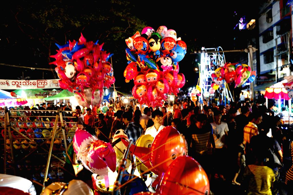YANGON, Oct. 14, 2016 - People celebrate during a Thadingyut Festival celebration in Yangon, Myanmar, Oct. 13, 2016. The Thadingyut Festival, the Lighting Festival of Myanmar, is held on the full ...