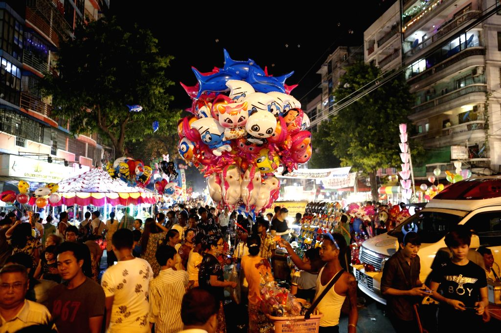 YANGON, Oct. 14, 2016 - People celebrate the Thadingyut Festival in Yangon, Myanmar, Oct. 13, 2016. Thadingyut Festival, the Lighting Festival of Myanmar, is held on the full moon day of the Burmese ...