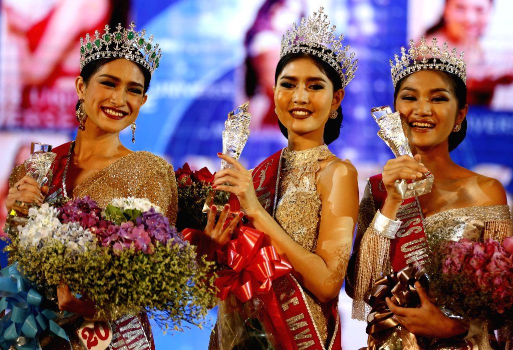 YANGON, Oct. 7, 2016 - Zun Than Zin (C) poses after winning the crown during the Miss Universe Myanmar 2017 pageant in Yangon, Myanmar, Oct. 6, 2016. Myanmar on Thursday selected Zun Than Zin as a ...