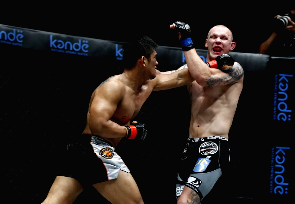 YANGON, Oct. 8, 2016 - Mixed Martial Arts (MMA) fighter Aung La N Sang (L), also known as the Myanmar Python, fights Michal Pasternak of Poland during the ONE Championship at the Thuwanna Stadium in ...