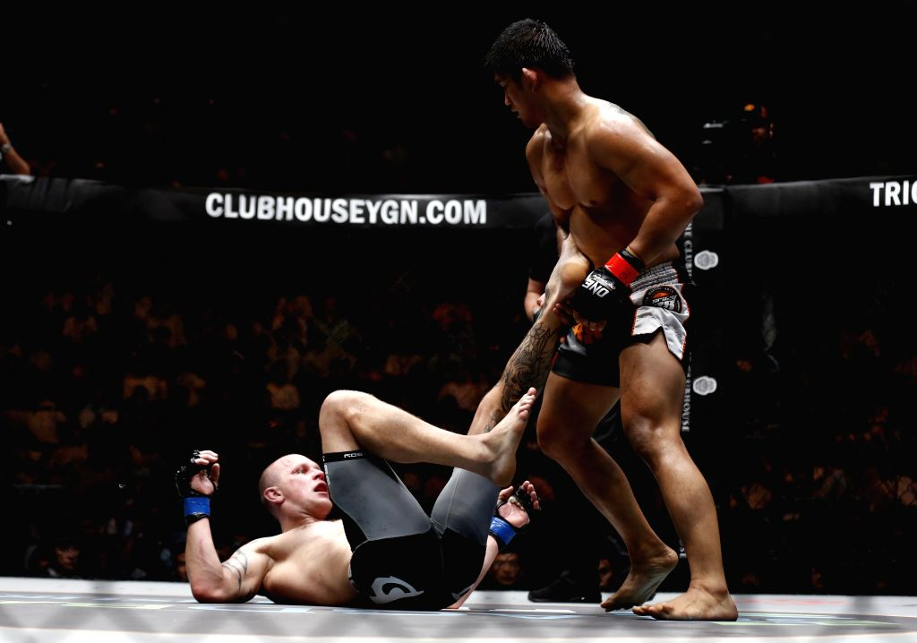 YANGON, Oct. 8, 2016 - Mixed Martial Arts (MMA) fighter Aung La N Sang (R), also known as the Myanmar Python, fights against Michal Pasternak of Poland during the ONE Championship at the Thuwanna ...