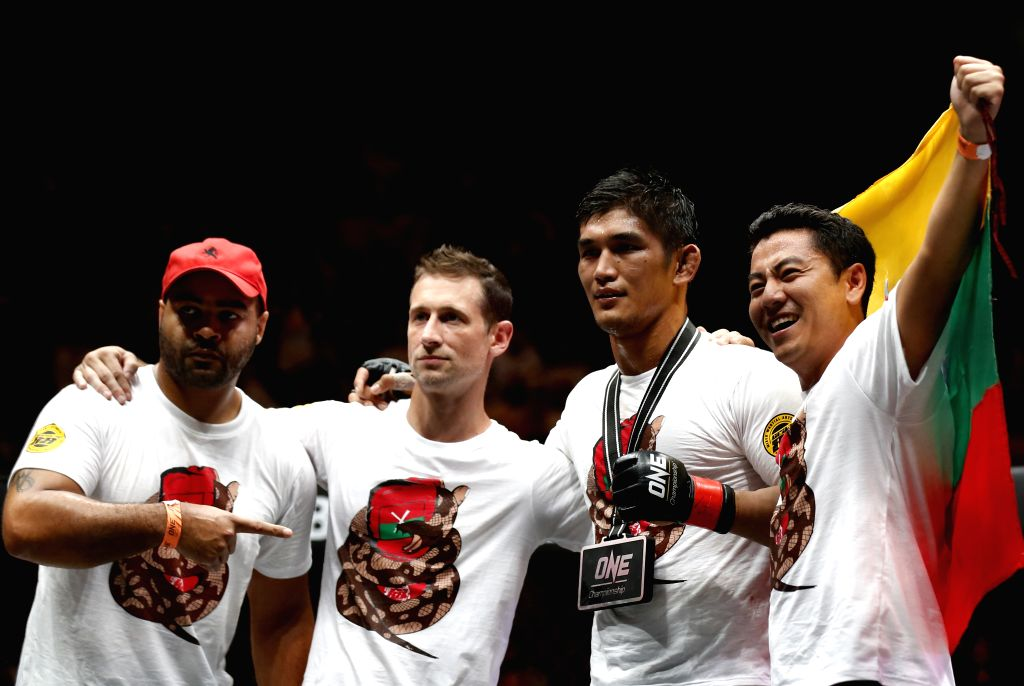 YANGON, Oct. 8, 2016 - Mixed Martial Arts (MMA) fighter Aung La N Sang (2nd R), also known as the Myanmar Python, poses after winning against Michal Pasternak of Poland during the ONE Championship at ...