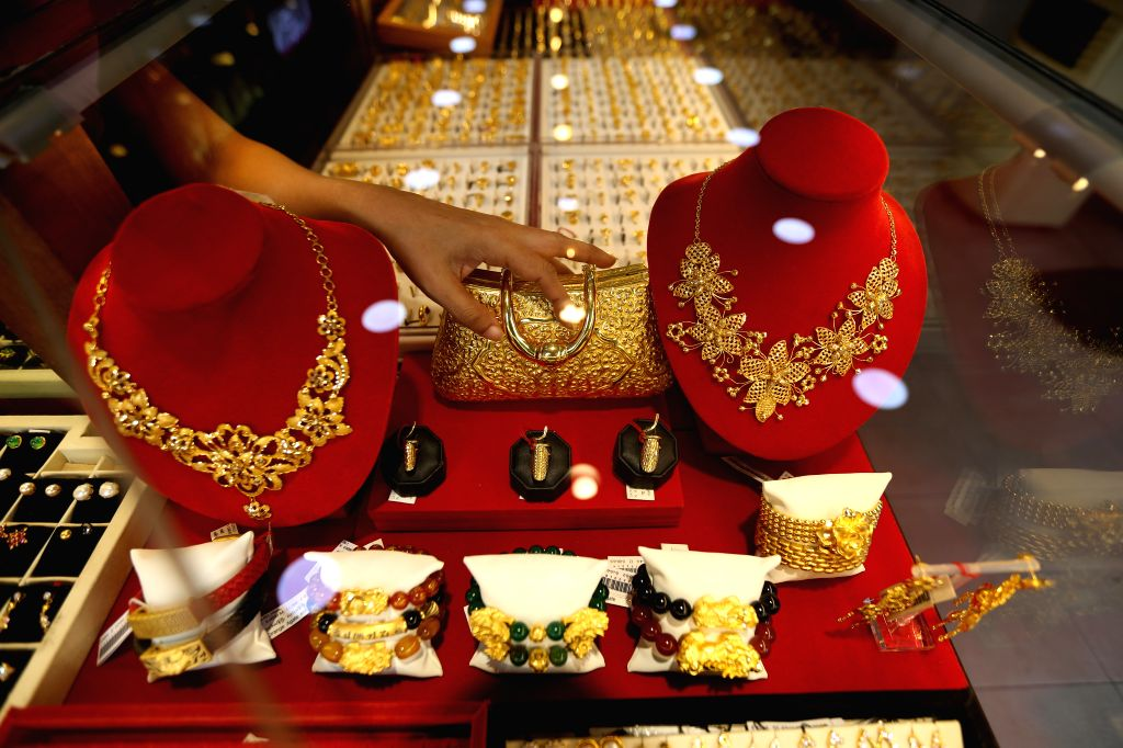 YANGON, Sept. 6, 2019 - Gold products are displayed at a jewelry shop in Yangon, Myanmar, Sept. 6, 2019. Myanmar's domestic gold price unprecedentedly reached its highest record of 1.3 million kyats ...