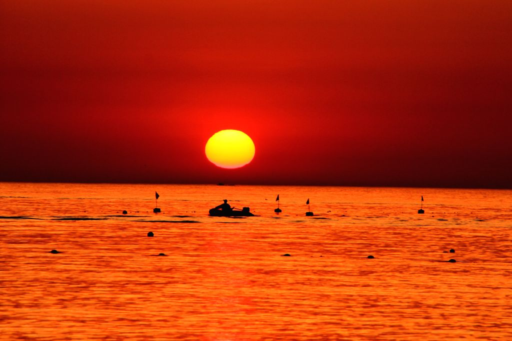 YANTAI, June 2, 2016 - Sun rises above the sea in Penglai City, east China's Shandong Province, June 2, 2016.