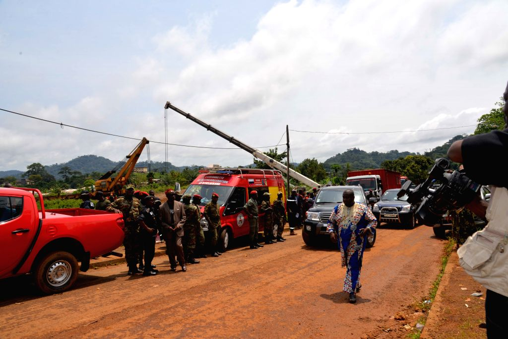 YAOUNDE, Oct. 24, 2016 - Local army guard at the site of train derailment accident in Eseka station in Central Region, about 120 km southwest of capital Yaounde, Cameroon, Oct. 23, 2016. According to ...