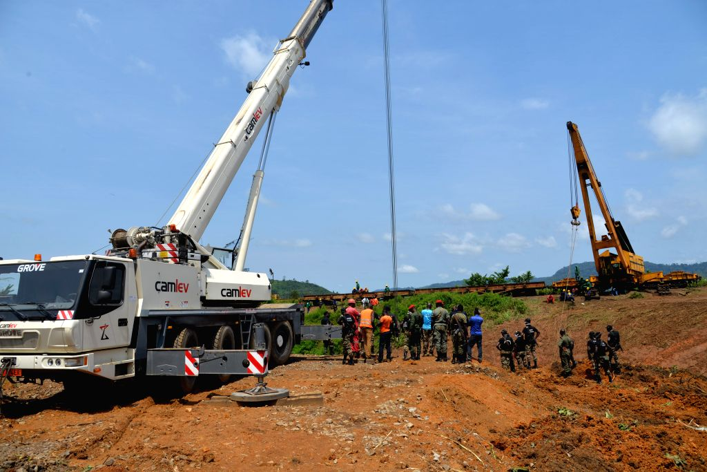 YAOUNDE, Oct. 24, 2016 - Rescue team work at the site of train derailment accident in Eseka station in Central Region, about 120 km southwest of capital Yaounde, Cameroon, Oct. 23, 2016. According to ...